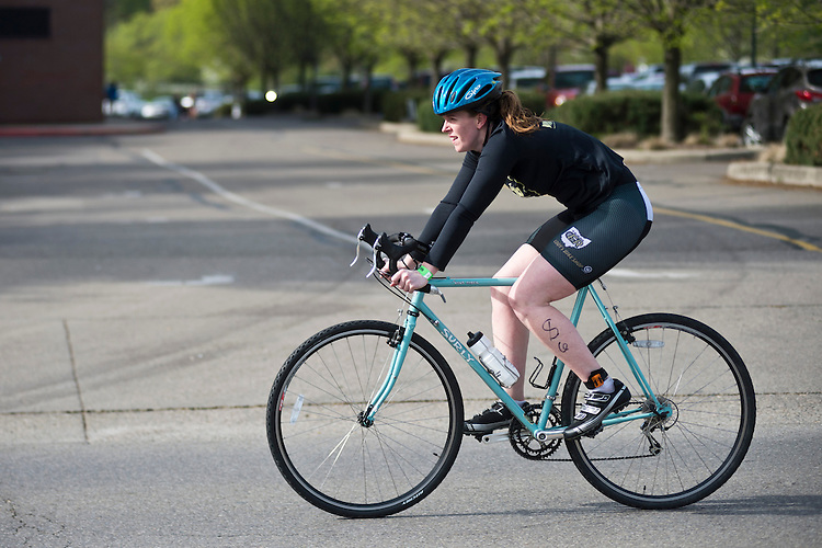 Julie Krause bikes during the O'Bleness Race for a Reason Triathlon Saturday, April 27, 2013. The triathlon included a 500mm Serpentine Swim at the Ohio University Aquatic Center, a 15 mile bike ride to the Plains and back and then a 5k run that finished at Tailgreat Park across from Peden Stadium. Race for a Reason, Race 4 A Reason, Annual Events, Events, Students, Faculty & Staff