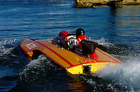 """Larry Lauterbach's """"old"""" raceboat """"Gemni"""" takes off from the dock."""