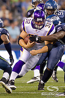 Minnesota Vikings running back Toby Gerhart (32) breaks past the Seattle Seahawks defense for a gain of 6 yards at CenturyLink Field in Seattle, Washington.