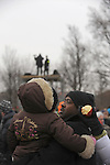 "A man stands in the crowd with a child during the ""We Are One"" concert in celebration of Barack Obama's inauguration as president of the United States at the Lincoln Memorial in Washington DC on January 18, 2009."