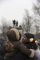 """A man stands in the crowd with a child during the """"We Are One"""" concert in celebration of Barack Obama's inauguration as president of the United States at the Lincoln Memorial in Washington DC on January 18, 2009."""