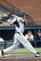 Oakland Golden Grizzlies outfielder Myles Zilinsky (3) follows through on his swing against the Michigan Wolverines on May 17, 2016 at Ray Fisher Stadium in Ann Arbor, Michigan. Oakland defeated Michigan 6-5 in 10 innings. (Andrew Woolley/Four Seam Images)