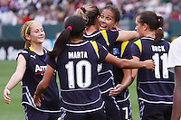 Shannon Boxx #7 and members of the Los Angeles Sol celebrate scoring a goal against St. Louis Athletica during their WPS game at Home Depot Center on May 30, 2009 in Carson, California. LA Sol defeated  St. Louis Athletic 2-0.