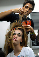 Model Viviane Orth make a gest during preparetion before parade designs of Graca Ottoni's 2009 spring/summer collection during the Fashion Rio Show, Rio de Janeiro, Brazil, June 11, 2008.  (Austral Foto/Renzo Gostoli)