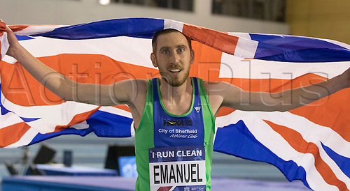 27.02.2016. EIS Sheffield, Sheffield, England. British Indoor Athletics Championships Day One. Lee Emanuel celebrates by holding the Union Jack after winning Gold in the 3,000m final.