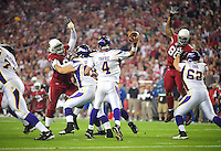 Dec 6, 2009; Glendale, AZ, USA; Minnesota Vikings quarterback (4) Brett Favre throws a pass in the first quarter under pressure from the Arizona Cardinals at University of Phoenix Stadium. Mandatory Credit: Mark J. Rebilas-