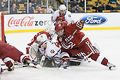 Ryan Carroll (Harvard - 35), Tyler McNeely (Northeastern - 94), Colin Moore (Harvard - 12) - The Northeastern University Huskies defeated the Harvard University Crimson 4-0 in their Beanpot opener on Monday, February 7, 2011, at TD Garden in Boston, Massachusetts.