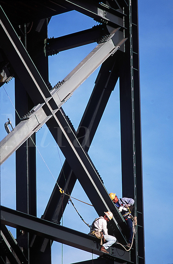Construction workers at work on steel highrise building.