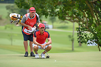 Zheng Kai BAI (CHN) lines up his putt on 11 during Rd 4 of the Asia-Pacific Amateur Championship, Sentosa Golf Club, Singapore. 10/7/2018.<br /> Picture: Golffile | Ken Murray<br /> <br /> <br /> All photo usage must carry mandatory copyright credit (&copy; Golffile | Ken Murray)