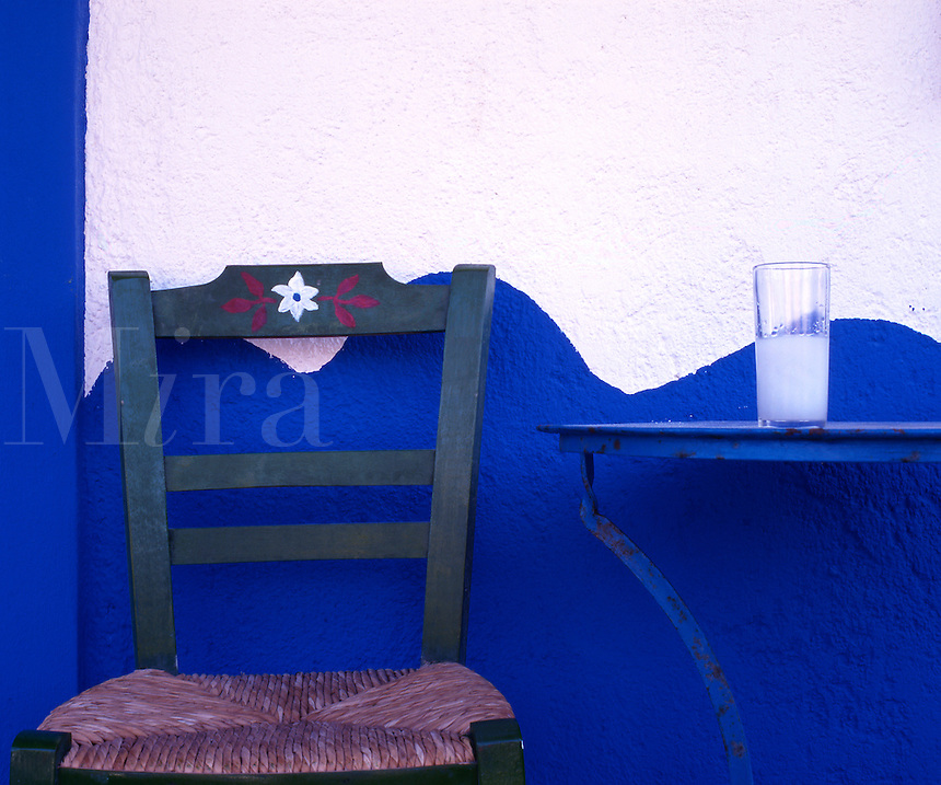 A glass of ouzo on a taverna table. South Crete. Greece.