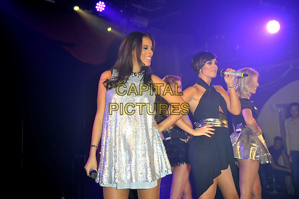 The Saturdays  -  Rochelle  Humes, Una Healy, Frankie Sandford and Mollie King.The Saturdays performing at G-A-Y, Heaven Night Club, London, England, UK, 23rd March 2013..half length music gig live on stage band girl group microphone  black top gold silver pregnant singing dress .CAP/MAR.© Martin Harris/Capital Pictures.