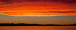 """Burning Sky"" Small Panoramic- I made this smaller version of the large panoramic due to the enormous size of the large one. Two sample sizes are 24x60"" and 44x110""  I captured this amazing sunset over Lake Tahoe from Zephyr Cove Beach located on the Nevada side of South Lake Tahoe on June 8th, 2013. That week the clouds were developing every day with the potential to be a spectacular sunset. Every night I shot from a different location in South Shore with this particular night turning into the most amazing sunset I have ever seen in my 30 years of living here.  The color of the water turned completely red. Normally you have a little color on the clouds and it reflects in the water but on this night it turned the whole entire lake red like I have never seen before anywhere in the world."
