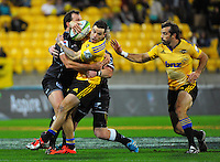 James Marshall is wrapped up during the Super Rugby match between the Hurricanes and Sharks at Westpac Stadium, Wellington, New Zealand on Saturday, 9 May 2015. Photo: Dave Lintott / lintottphoto.co.nz
