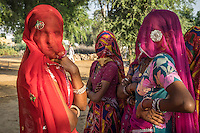A group of women who are a part of Technoserve's kitchen garden program, gather for a training in Bamanwali village, Bikaner, Rajasthan, India on October 24th, 2016. Non-profit organisation Technoserve works with guar farmer's wives in Bikaner, providing technical support and training for edible gardening, to improve the nutritional quality of their food and relieve financial stress on farming communities. Photograph by Suzanne Lee for Technoserve