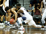 SIOUX FALLS, SD - MARCH 22: Ike Agusi #0 from Queens (NC) battles for the ball with Ian Smith #0 from Northern State during their semifinal game at the 2018 Elite Eight Men's NCAA DII Basketball Championship at the Sanford Pentagon in Sioux Falls, SD. (Photo by Dave Eggen/Inertia)