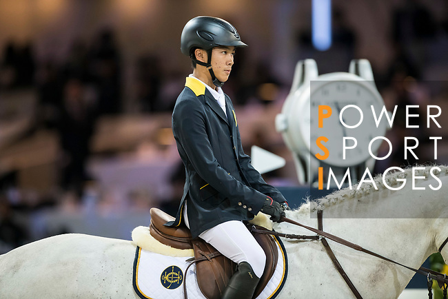 Justin Yeung of Hong Kong riding Clintorado competes in the HKJC Junior Trophy during the Longines Masters of Hong Kong at AsiaWorld-Expo on 11 February 2018, in Hong Kong, Hong Kong. Photo by Diego Gonzalez / Power Sport Images