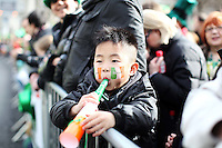 17/3/2011. ST PATRICKS DAY DUBLIN. 5 yr old Gerry Wong from Japan is pictured on College Green enjoying the Dublin St Patricks Day Parade. Picture James Horan/Collins Photos