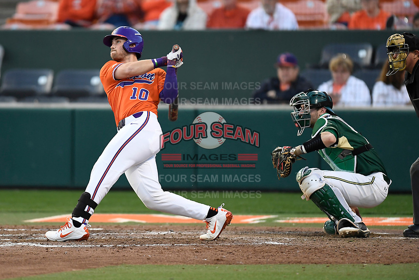 Catcher Kyle WIlkie (10) of the Clemson Tigers bats in a game against the William and Mary Tribe on February 16, 2018, at Doug Kingsmore Stadium in Clemson, South Carolina. The catcher is Hunter Smith. Clemson won, 5-4 in 10 innings. (Tom Priddy/Four Seam Images)