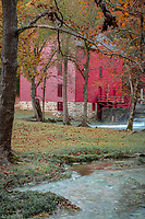 "Alley Spring is an unincorporated community in Shannon County, Missouri. Alley Spring the 7th largest spring in Missouri with a discharge of 81 million gallons per day.  The scenic Alley Mill, or ""Old Red Mill"" is located there on a spring and is located in the Ozark National Scenic Riverways.  It was built in 1893, and is a 2 1/2-story, rectangular frame building on a limestone block foundation. It measures 32 feet by 42 feet and houses four steel rollers and a single stone burr.  The Mill is operated as an Ozarks history museum. Nearby a one room schoolhouse and general store add to the feeling of the restored historic hamlet. It once had a post office, but it is now closed and mail now comes from Eminence. The community is named after John Alley, a miller. It was originally named Mammoth Spring and later Barksdale Spring. These names were deemed too long by the Post Office Department of the time, so the village was renamed after a prominent local citizen, John Alley. It was listed on the National Register of Historic Places in 1981."