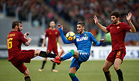 Calcio, Serie A: AS Roma - Sassuolo, Roma, stadio Olimpico, 30 dicembre 2017.<br /> Sassuolo's Antonio Ragusa (c) in action with Roma's Daniele De Rossi (l) and Federico Fazio (r) during the Italian Serie A football match between AS Roma and Sassuolo at Rome's Olympic stadium, 30 December 2017.<br /> UPDATE IMAGES PRESS/Isabella Bonotto