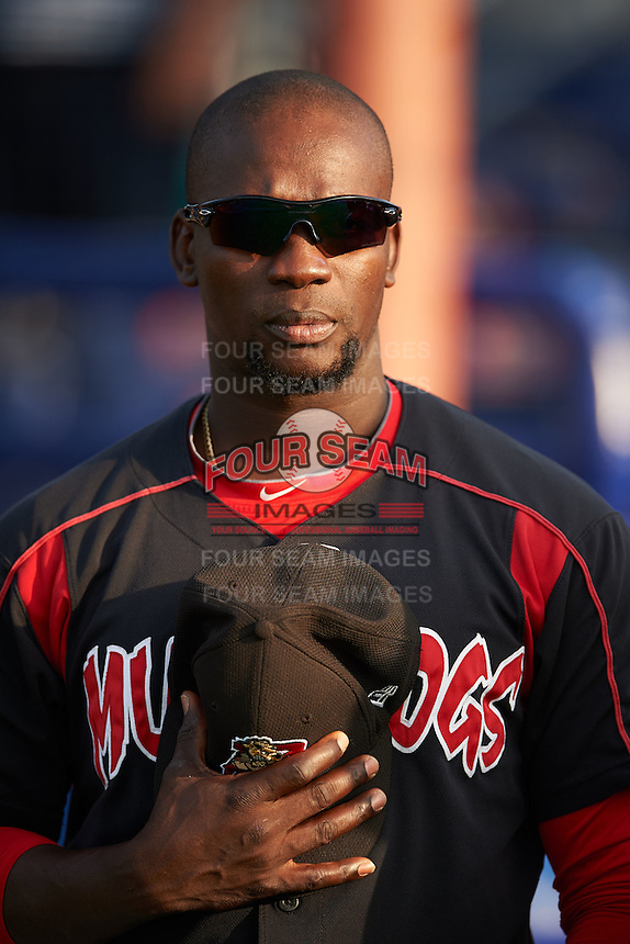 Batavia Muckdogs hitting coach Rigoberto Silverio (18) during the national anthem before a game against the Auburn Doubledays July 10, 2015 at Dwyer Stadium in Batavia, New York.  Auburn defeated Batavia 13-1.  (Mike Janes/Four Seam Images)