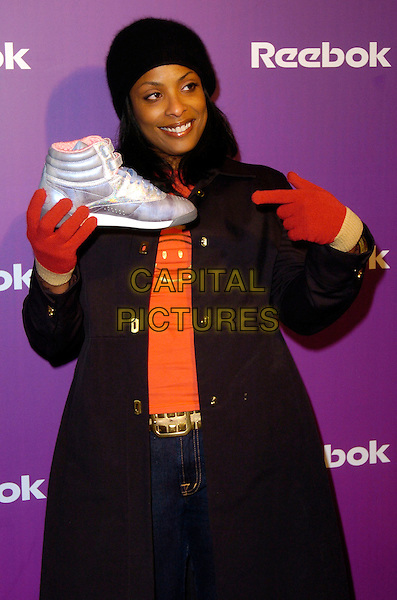 "DJ SPINDERELLA.At the Reebok 25th anniversary celebration of ""The Freestyle"" at Culture Club, New York, New York, USA,.21 February 2007..half length spindarella black hat red gloves pointing holding shooe trainer.ADM/BL.©Bill Lyons/AdMedia/Capital Pictures. *** Local Caption ***"