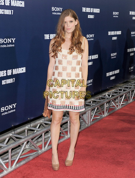 Kate Mara.The L.A. Premiere of 'The Ides of March' held at The Academy of Motion Picture Arts & Sciences  in Beverly Hills, California, USA..September 27th, 2011.full length white beige paillettes sequins sequined dress check brown clutch bag shoes .CAP/RKE/DVS.©DVS/RockinExposures/Capital Pictures.