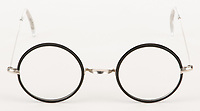 BNPS.co.uk (01202 558833)<br /> Pic: ProfilesInHistory/BNPS<br /> <br /> Harry Potter's glasses from the Philosopher's Stone have emerged for sale for £25,000. ($30,000)<br /> <br /> Daniel Radcliffe wore the custom made silver wire frame spectacles with black rims during the 2001 film which was the first of the franchise.<br /> <br /> They were rented to the film's production company Warner Brothers from an English glasses company.<br /> <br /> The glasses have clear glass lenses, no nose guard and clear rubber temple tips, with one of the tips bearing chew marks.