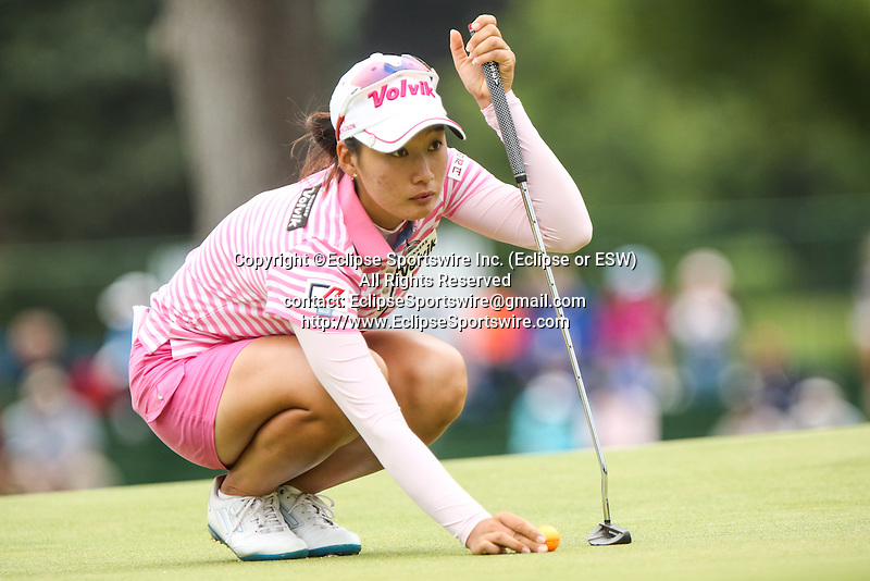 Chella Choi reviews the 10th green at the LPGA Championship 2014 Sponsored By Wegmans at Monroe Golf Club in Pittsford, New York on August 16, 2014