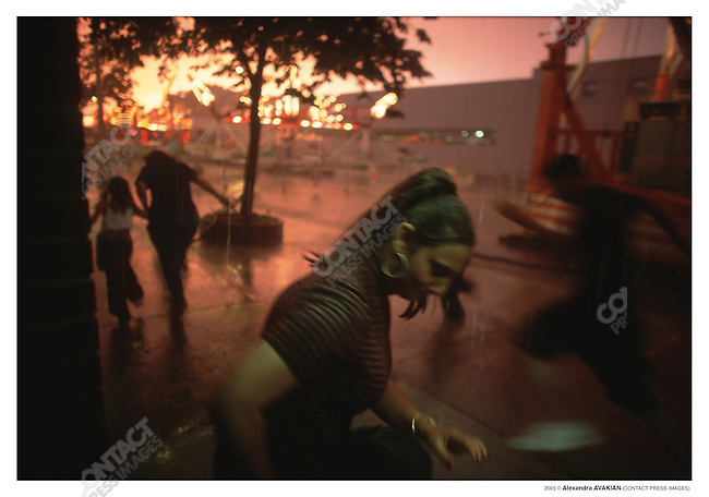 Caught in the rain at the Arab International Festival; Dearborn, Michigan, June 2002