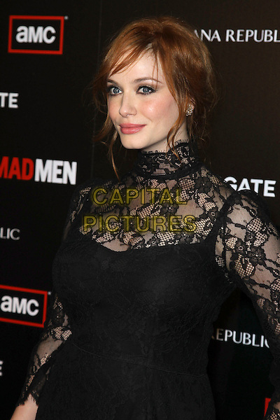 """CHRISTINA HENDRICKS.at the Season 4 premiere of AMC's """"Mad Men"""", Mann Chinese 6 Theatre. Hollywood, CA, USA, July 20th, 2010. .half length long sleeve dress  polo high neck sheer see thru through fringe hair up make-up fishnet lace black .CAP/CEL.©CelPh/Capital Pictures."""