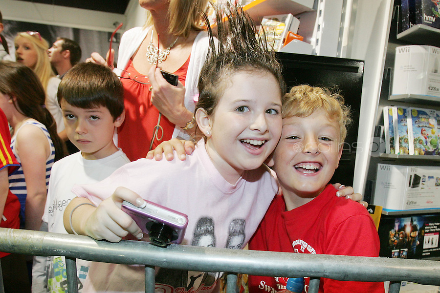 16/7/2010. Jedward fans Rosin Walsh and Luke Nolan are pictured at the launch of the new Jedward .album at HMV Dundrum. Picture James Horan/Collins Photos