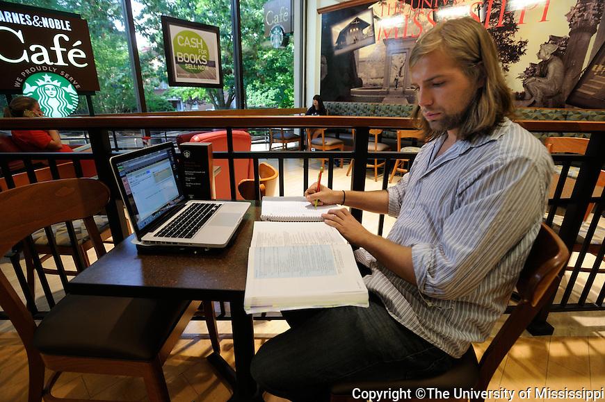 Kaleb Hilton studies in the bookstore.  Photo by UM Photographer Kevin Bain