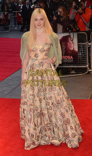 Elle Fanning .arriving at the premiere for 'Ginger and Rosa' during the London Film Festival, London, England, UK, .October 13th 2012..full length strapless floral print peach yellow beige dress green cardigan hand on hip over shoulders long maxi lace choker .CAP/WIZ.© Wizard/Capital Pictures.