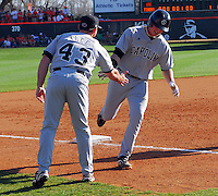 University of South Carolina first baseman Justin Smoak (12)  is congratulated by coach Monte Lee (43) after hitting a home run in a game between the Clemson Tigers and USC Gamecocks on March 2, 2008, at Doug Kingsmore Stadium in Clemson. Photo by: Tom Priddy/Four Seam Images