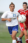 BROOKINGS, SD - AUGUST 16:  Stacy Guijarro #21 from South Dakota State University chases down the ball past Margo Gerrard #12 from Winnipeg in the first half of their game Friday evening at Fischback Soccer Field in Brookings. (Photo by Dave Eggen/Inertia)