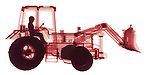X-ray image of a utility tractor (red on white) by Jim Wehtje, specialist in x-ray art and design images.