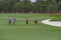 Brooks Koepka (USA) and C.T. Pan (TAI) approach their next shots on 9 during round 4 of The Players Championship, TPC Sawgrass, at Ponte Vedra, Florida, USA. 5/13/2018.<br /> Picture: Golffile | Ken Murray<br /> <br /> <br /> All photo usage must carry mandatory copyright credit (&copy; Golffile | Ken Murray)