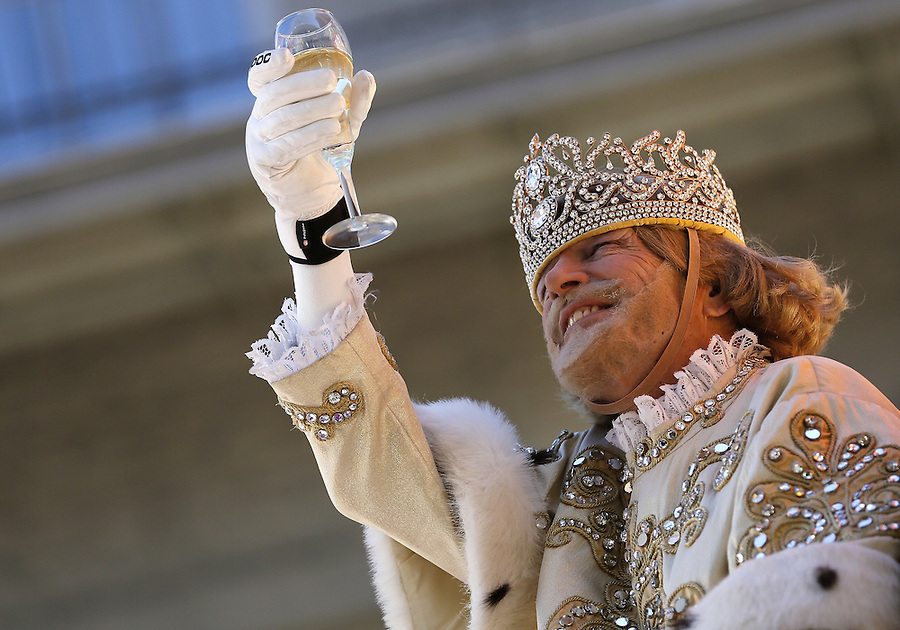 NEW ORLEANS, LOUISIANA - FEBRUARY 9, 2016:  Rex, King of Carnival, Michael W. Kearney, toasts his queen  during Mardi Gras day on February 9, 2016 in New Orleans, Louisiana. Fat Tuesday, or Mardi Gras in French, is a celebration traditionally held before the observance of Ash Wednesday and the beginning of the Christian Lenten season. (Photo by Jonathan Bachman/Getty Images)