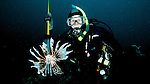 Diver and speared Lionfish, Islamorada, Florida