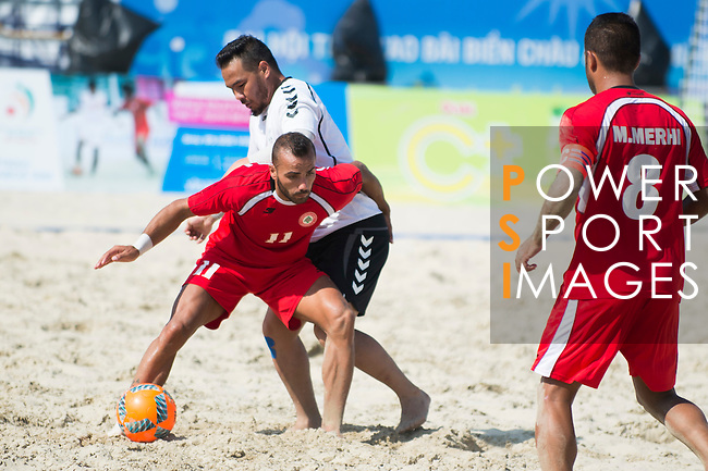 JALAL Sameh of Lebanon fights for the ball with GULZAR Hamidullah of Afghanistan during the Beach Soccer Men's Team Bronze Medal Match between Lebanon and Afghanistan on Day Nine of the 5th Asian Beach Games 2016 at Bien Dong Park on 02 October 2016, in Danang, Vietnam. Photo by Marcio Machado / Power Sport Images