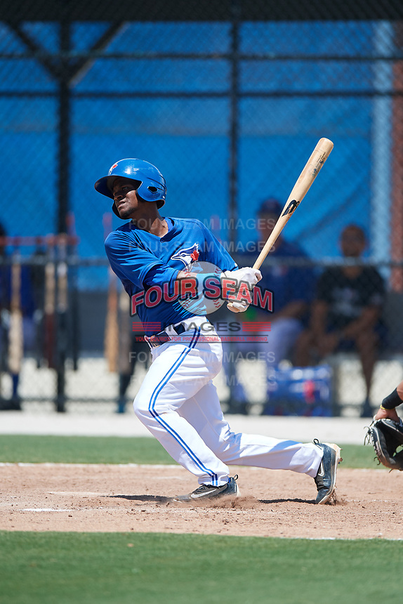 GCL Blue Jays third baseman Otto Lopez (3) follows through on a swing during a game against the GCL Pirates on July 20, 2017 at Bobby Mattick Training Center at Englebert Complex in Dunedin, Florida.  GCL Pirates defeated the GCL Blue Jays 11-6 in eleven innings.  (Mike Janes/Four Seam Images)