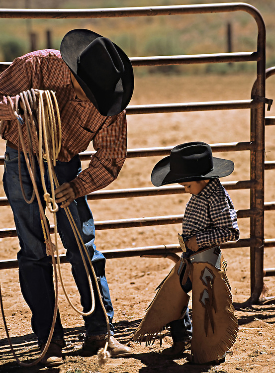 After watching a demonstration on how to hold the rope while hooking cattle horns, Kory, age 4, shares his expert opinion with his coach.