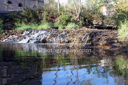 The Menomonee River and Falls in front of the historic Lime Kilns preserved in a park