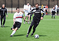 Thursday 11 April 2013<br /> Pictured L-R: Swansea City press officer Chris Barney against assistant manager Morten Wieghorst.<br /> Re: Friendly game, Swansea City FC coaching staff v sports reporters at the Swansea City FC training ground. Final score 10-4.