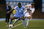18 October 2013: North Carolina's Omar Holness (JAM) (14) and Syracuse's Juuso Pasanen (FIN) (6). The University of North Carolina Tar Heels hosted the Syracuse University Orangemen at Fetzer Field in Chapel Hill, NC in a 2013 NCAA Division I Men's Soccer match. UNC won the game 1-0.