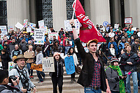 Ivan Kroupin (center), 24, is a Harvard Ph.D. student in psychology and lead organizer for the Harvard Cambridge campus March for Science demonstration. He is seen here leading a group of people from the Harvard rally after marching to MIT in Cambridge, Mass., on Sat., April 22, 2017. The combined groups then marched to Boston Common.