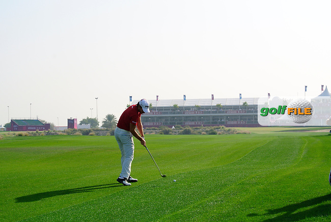 Alejandro Canizares (ESP) plays his 2nd shot on the 18th hole during Saturday's Final Round of the Commercial Bank Qatar Masters 2014 held at Doha Golf Club, Doha, Qatar. 25th January 2014.<br /> Picture: Eoin Clarke www.golffile.ie
