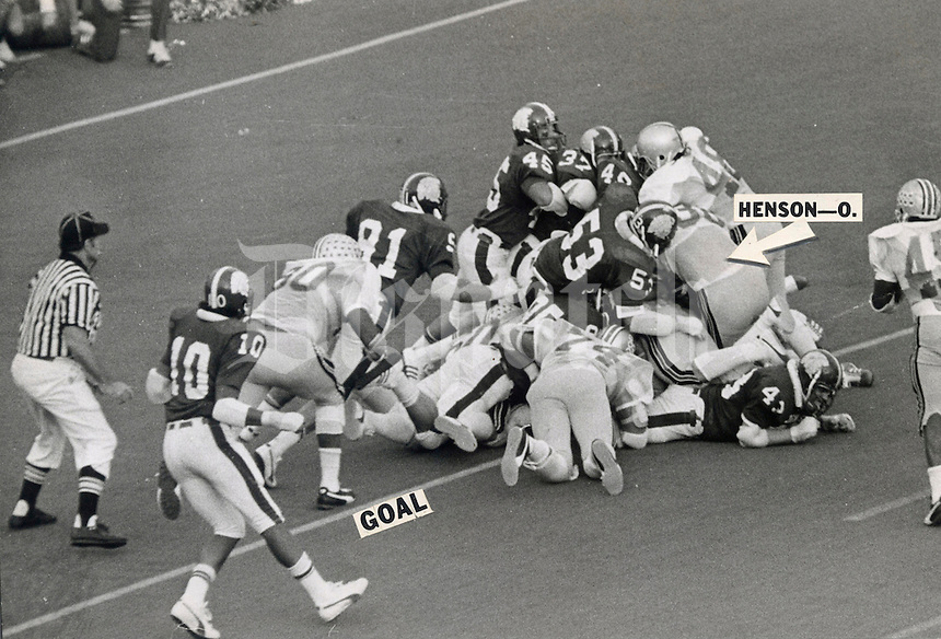 "Black and white file photo - OSU-MICHIGAN STATE GAME 1974 - November 9, 1974  TD, OR NO? -- Officials ruled that Ohio State fullback Champ Henson (38) failed to break the plane of the goal line on this plunge over right tackle in the final seconds of Saturday's game at Michigan State. Time ran out before another play, giving Michigan State a 16-13 upset victory. Judge for yourself in this Dispatch photo whether you agree with Henson that ""I was over the goal line.""   (Columbus Dispatch photo)"