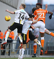 Blackpool's Armand Gnanduillet heads past Burton Albion's Damien McCrory (left) and Scott Fraser but misses the target<br /> <br /> Photographer Stephen White/CameraSport<br /> <br /> The EFL Sky Bet League One - Blackpool v Burton Albion - Saturday 24th November 2018 - Bloomfield Road - Blackpool<br /> <br /> World Copyright © 2018 CameraSport. All rights reserved. 43 Linden Ave. Countesthorpe. Leicester. England. LE8 5PG - Tel: +44 (0) 116 277 4147 - admin@camerasport.com - www.camerasport.com